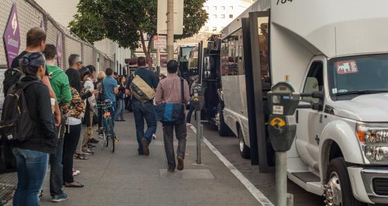 Tech workers lined up in San Francisco's South of Market for their shuttles to work.