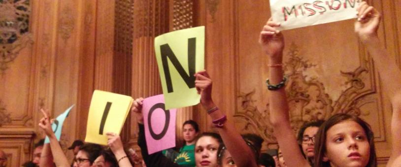 Youth hold up signs in support of Moratorium
