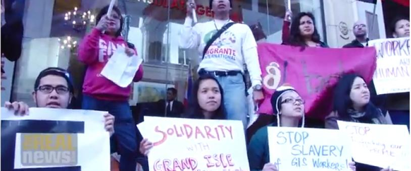 Filipino-Americans hold signs against modern slavery in New Orleans
