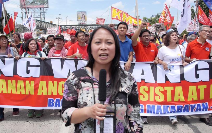 Dyan in front of crowd at the People's State of the Nation rally in Manila